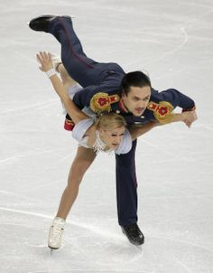 Volosozhar-Trankov lead pairs after short program - Tatiana Volosozhar and Maxim Trankov of Russia compete in the pairs short program figure skating competition at the Iceberg Skating Palace during the 2014 Winter Olympics, Tuesday, Feb. 11, 2014, in Sochi, Russia. (AP Photo/Bernat Armangue)