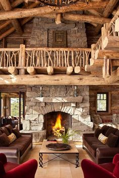 Log home living room with fireplace and upstairs.