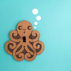 Cute idea for kid's room. Our Happy Octopus is a wood light switch plate cover for a kids ocean theme decor room or nursery. We laser cut & engrave from cherry wood.