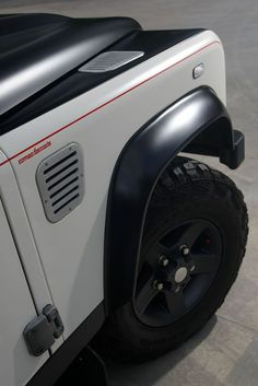 The Aznom Land Rover Defender sits on new alloy black rims and Kumho tires which are accented by the custom paint job. Description from roverparts.com. I searched for this on bing.com/images