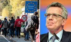 EUROPE DISINTEGRATES: Now Germany threatens SANCTIONS against EU states over migrant chaos  A CAVERNOUS division opened up between Germany and the rest of Europe today after Angela Merkel's right-hand man threatened sanctions against EU members who fail to control the migrant influx.  Thomas de Maiziere, right, and migrants arrive in Germany, left
