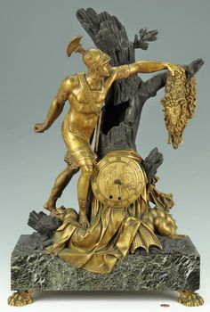 French Restoration Period Gilt And Patinated Bronze French Mantle Clock, Depicting The Mythological Jason, Capturing The Golden Fleece With The Head Of The Slain Hydra At His Feet