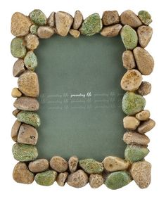 Take a look at this River Rock Frame....... something to do with the Dollar Store rocks
