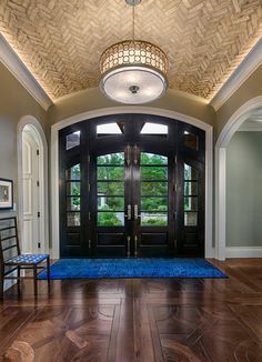 OH MY WHAT AN ENTRANCE! Check out the rustic tile on the ceiling, the dark stained doors and hardwood floors. Rich, warm and inviting.