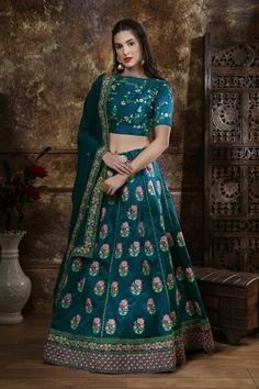 Teal Blue Color Thai Silk Zari Embroidered Bridal Lehenga Product Details : Fabric of this lehenga is thai silk. Comes along with a thai silk choli and bridal net dupatta. Lehenga color is teal blue. Lehenga has thread and zari embroidery work. New Lehenga Choli, Green Lehenga, Ghagra Choli, Lehenga Choli Online, Indian Lehenga, Silk Dupatta, Pakistani, Salwar Kameez, Costumes Anarkali