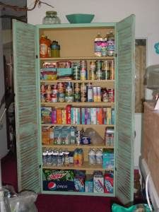 pantry, closet, craft space, whatever: 1 bookshelf + added front trim + store bought shutters and paint = an easy project.