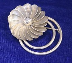 Appraised $245 1940's Georg Jensen #103 Sterling Silver Flower Brooch I7. For sale on eBay, £62.25 ($99.99).