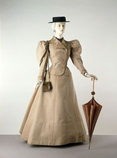 1895 (made) This suit might well have been worn for a tour abroad. When it was conserved, reddish-brown dust was found on the surface. Linen was particularly popular for hot-weather travel because it was washable and comparatively lightweight. At this period, women's tailored suits had become very popular. They borrowed details from men's dress, such as wide lapels and exterior pockets. This practical style suited the more emancipated lifestyles women were then leading.