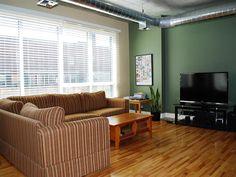 Gorgeous hardwood floors, high ceilings, and large windows with an abundance of light (3/10)