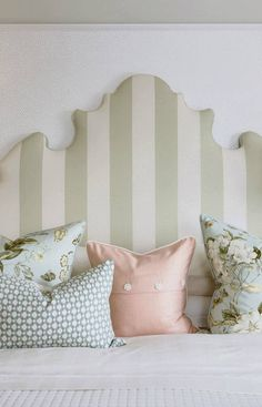 (Sarah Richardson) A wide tent stripe on a tall headboard offers the illusion of height in a room that has eight-foot-tall ceilings, while pillows sporting a graphic weave, elegant florals and a peach-toned wool gabardine top a quilted bedspread to add luxe and texture to the bed.