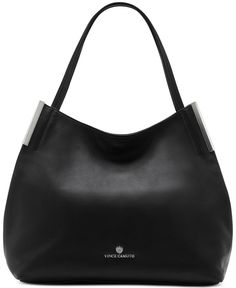 Vince Camuto Tina tote — this simple silhouette is perfect for the girls who like to keep their looks laidback. With a relaxed poncho and leggings, you'll take on the weekends with effortless style