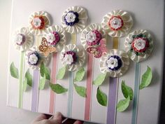 yo yo flower canvas. Could use this idea for cards or bookmarks