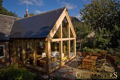 Oak Sun Rooms, Orangeries, Garden Rooms and Conservatories - Oak frame extension. Enhance your home with a beautiful and bespoke oak extension. room extensions Spectacular oak frame garden room with glazed gable Orangery Extension, Cottage Extension, Rear Extension, Garden Room Extensions, House Extensions, Oak Framed Extensions, Sunroom Addition, Casa Patio, Room Additions