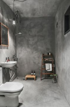 The Bathroom Walls Are Finished In Concrete Photo Laure Joliet