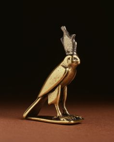 The falcon god Horus represented the sky and was also associated with kingship from the late 4th millennium. This small falcon figure is made from gold and has a silver double-crown (which stands for Upper and Lower Egypt) attached.