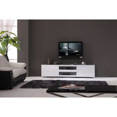 @Overstock - Smooth, classy and intellectual, this television stand represents the simple tranquility of modern entertaining. The striking white high gloss finish embraces the choreography of any modern living room.http://www.overstock.com/Home-Garden/Firenze-White-Two-drawer-Modern-TV-Stand/5899956/product.html?CID=214117 $828.89
