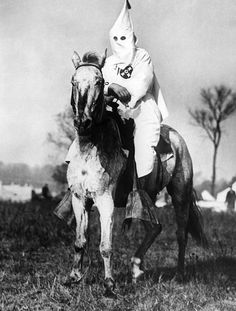 Klansman doing sentry duty near the Klan encampment at Kiles, Ohio. After the Klan targeted the ethically diverse (Irish and Italian) town for an intimidating parade, an anti-Klan organization, the Knights of the Flaming Circle come forward to resist. The result was riot and the arrest of over 100 people. Nov. 1924.
