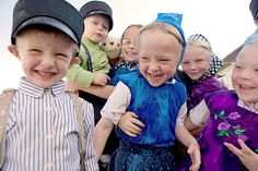 Hutterite communities are very interesting. Mostly they still speak German. The dress of plaid with flowers is much like Romanians. From what i see-- the kids are blonde, blue eyed. Like Germans -- Hutterites -- what book do they follow? Like Canadian Amish folks.