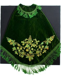 c. 1850  This emerald green short cape was worn by Elizabeth Washington Burnet (c. 1807-1852), the first wife of Robert Barnwell Rhett of Beaufort, c. 1850. The garment is lined with quilted white silk. Rhett was known as the Father of Secession for his fiery secessionist views. Charleston Museum flicker page