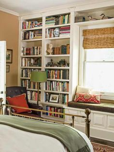 Built-in bookcases and a window seat frame the one window in this master bedroom. | Photo: Mark Lohman  Paint (walls): 3005-7C Woodlawn Lewis Gold, @valsparpaint