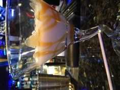 Dulce de Leche Martini - Invented by Bridget and I!  1.5 oz. Smirnoff Kissed Caramel Vodka 1.5 oz. White Chocolate Godiva Liquer Splash of Pinnacle Whipped Vodka  Drizzle caramel sauce in martini glass. Shake mix in shaker with ice till super chilled. Serve over the caramel and enjoy!