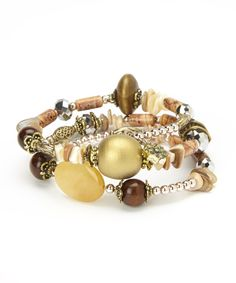 This Natural & Gold Bead Coil Bracelet by Embassy Jewels is perfect! #zulilyfinds