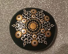 Silver and gold dotted mandala stone