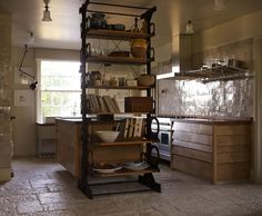 I love this tile and the angled drawer fronts by Retrouvius Reclamation and Design