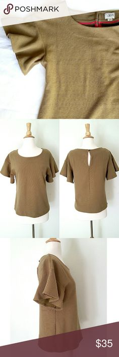 """Anthropologie Ruffle Sleeve Top Flirty and girly textured blouse by Postmark. 71% cotton 27% polyester 2% spandex. 18"""" armpit to armpit,  22"""" shoulder to bottom hem. It's a loose fit top. Has a shade of a stain inside the bottom hem (last pic) totally invisible since it's inside. In excellent condition. Anthropologie Tops Blouses"""