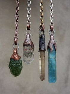 I have been asked by several Crystal Goddesses to create single crystal dangle earrings. So here we go, from left to right on the hanging earrings: Raw Moldavite - SOLD Amphibole Phantom Quartz Phantom Quartz Wand - SOLD Natural Formed Smoky Citrine Lemurian Seed Crystal Wand