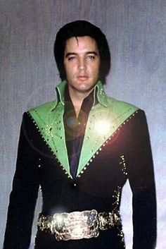 Elvis, as he said, wasn't the King, but he looks like a royal prince with the style of his clothes, his silver belt, for standing at attention and his facial expression. He was the king of rock and roll. He did a lot of good for people and I am glad to call him my hero.