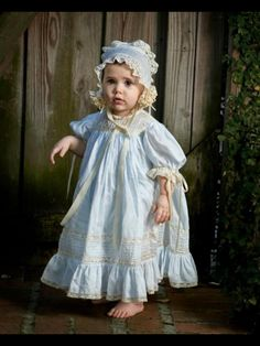 Charlotte is beautiful in her Mela Wilson dress and bonnet. Visit our Facebook page Mela Wilson Heirloom Children's Clothing
