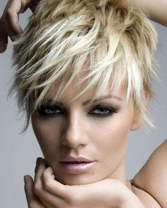 Short, blonde pixie crop with longer lengths in the fringe #choppy #hair