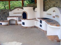 Compact outdoor kitchen with fire pit for cauldron, pizza oven, BBQ and traditional stove. Compact outdoor kitchen with fire pit for cauldron, pizza oven, BBQ and traditional stove. Backyard Kitchen, Outdoor Kitchen Design, Backyard Patio, Outdoor Cooking Area, Pizza Oven Outdoor, Bbq Area, Outdoor Living, Outdoor Fire, House Styles