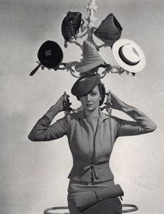 A 1937 promotion for Schiaparelli featuring a collection of her hats