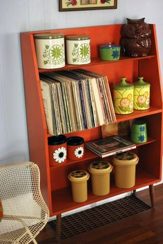 I really want a bookcase like this. Love the orange too but I would have to do a different color.  Elise's Eclectic Cottage in the Mountains