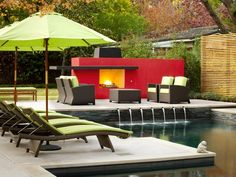 A red fireplaces is the focal point of this contemporary backyard. Design by Randy Angell.