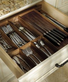Walnut Drawer Inserts In the kitchen organization is essential. What can be more frustrating than a messy cutlery drawer? These Walnut inserts will do more than keep you organized, they'll help you do it in style.