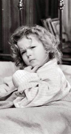 The adorable Shirley Temple. Deep in thought!