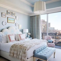 Gorgeous city view in this fabulous bedroom  designed by @andrewjhow.  So many things to love ❤️! What is your favorite element?