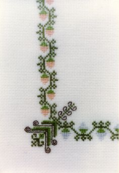 Baptism Sampler. Cross stitch worked on 28-count evenweave fabric. Detail of bottom left corner.