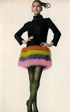 Benedetta in Cardin's marabou parfait of orange, pink, purple and green bands circling a black satin-back crepe short dress, photo by Penn, Vogue 1968