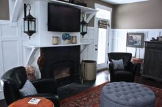 Love this living room wainscoting, fireplace & lanterns ~ from {family room done 3} ~ Cynthia Weber Interior Decorating