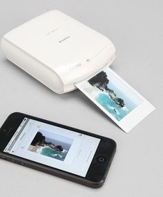 The instant smartphone printer lets customers print mobile photos instantly from their smart phone or tablet, anywhere, anytime. It acts as its own Wi-Fi hotspot, and works with both is and Android to get you instant film prints from any picture stored on your device.