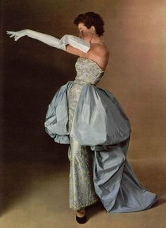 Model wearing an evening gown for L'Officiel, 1950s, Photo by Philippe Pottier.