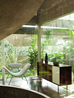 Brazilian Mid-century modern interior, Martin Eisler lounge chair, 1955, Brazil.