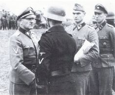 Sepp Dietrich with Max Wunsche, and Kurt Meyer decorating men of the Leibstandarte in 1941.