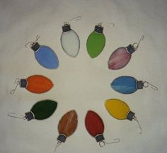 Stained Glass Christmas Ornaments. I am going to make these....Lots of scraps = Lights!!!