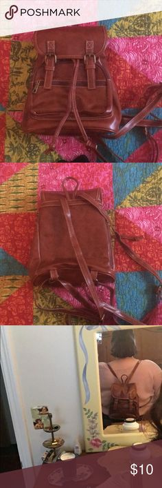 """Faux Leather Backpack Purse Faux leather, didn't come with rages but it's new and never used. Brass hardware. Will not hold textbooks, computer etc. it's more of a purse. But it will def hold a novel sized book! I will post a pic of all the things I can fit in it. There's a pic of me wearing it to show the size best. Great for everyday! 10""""x9""""x4"""". really adjustable straps! Kenox Bags Backpacks"""