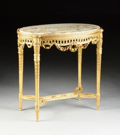 A LOUIS XVI STYLE MARBLE TOPPED PARCEL GILT AND CARVED : Lot 111